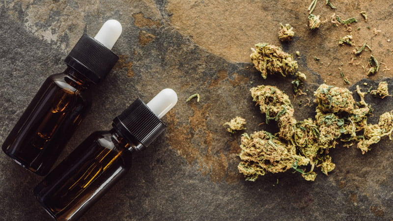 Image of terpenes bottle and marijuana flowers